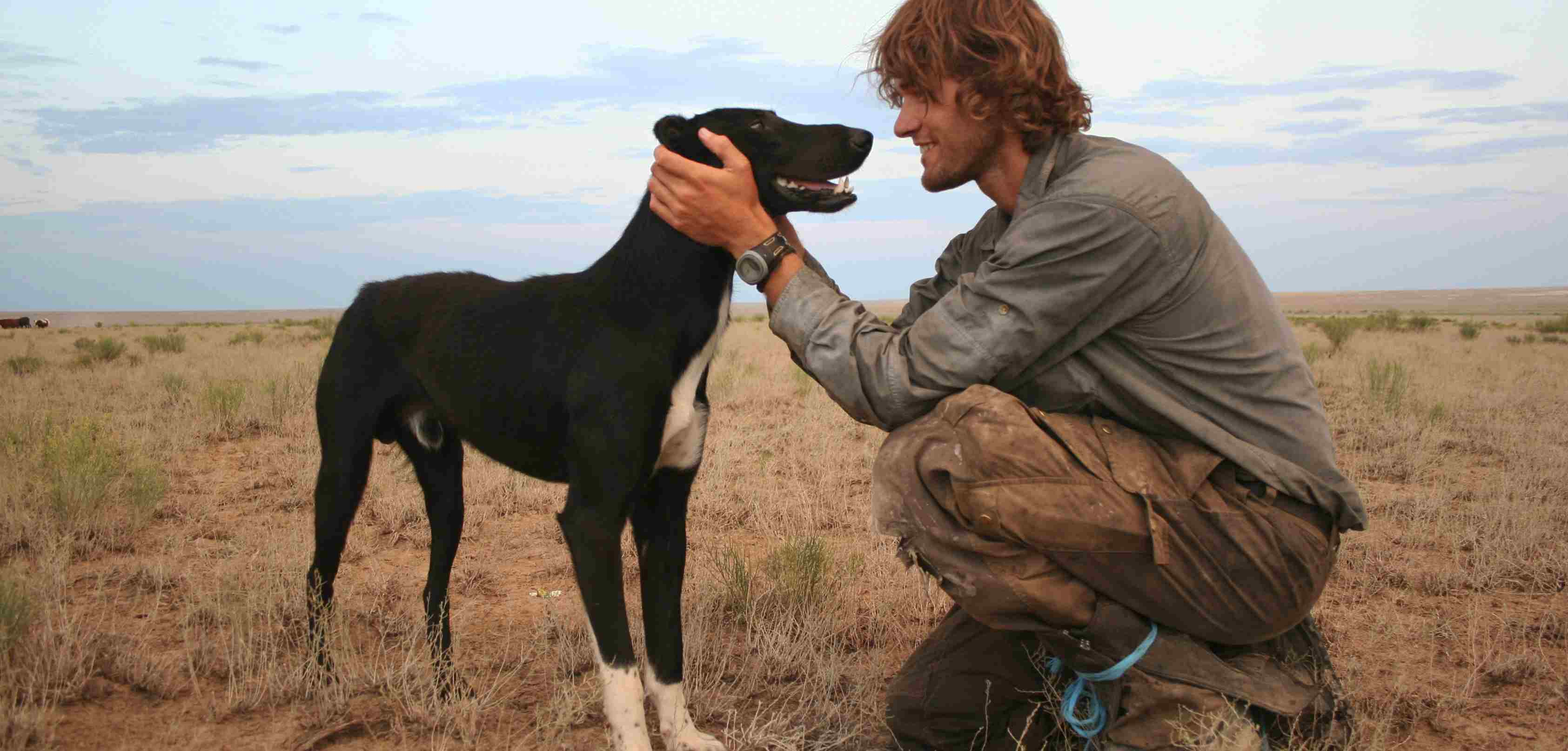 Photograph of Tim Cope and his dog Tigon