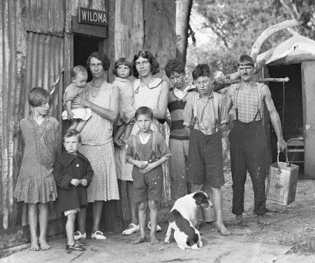 A family standing outside a tin shack called Wiloma during the Great Depression, New South Wales, ca. 1932