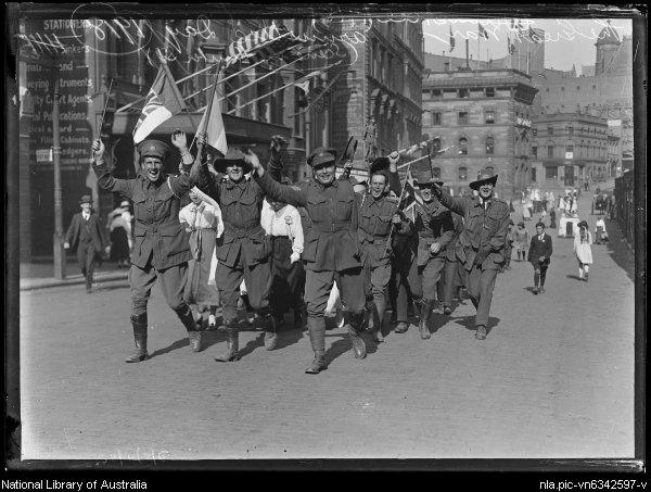 Crowd celebrates Armistice Day in Hunter Street, Sydney, 1918