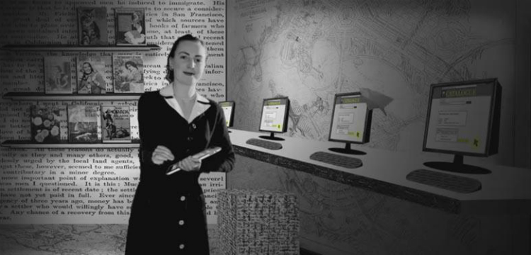 Librarian holding handheld electronic tablet near computers