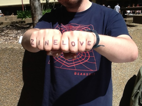 Zine Love written on hands