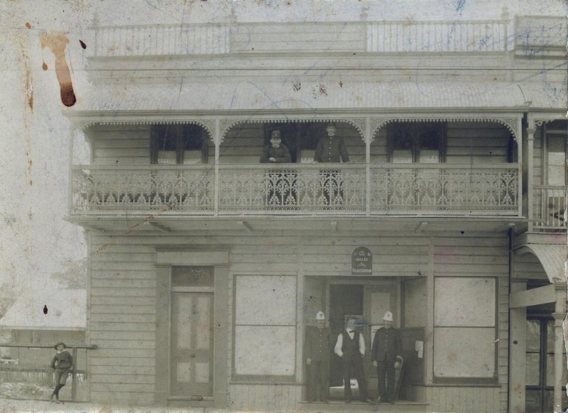 men standing outside building