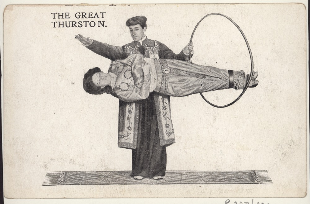 Early 20th century postcard showing the magician the Great Thurston doing a magic trick