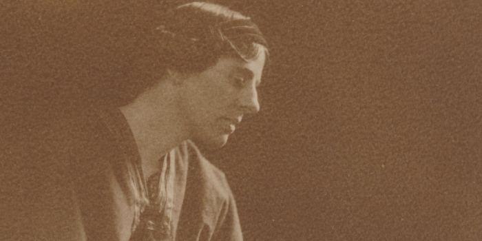 sepia photograph of Marion Mahoney Griffin in profile, showing her head, with short dark hair, and shoulders