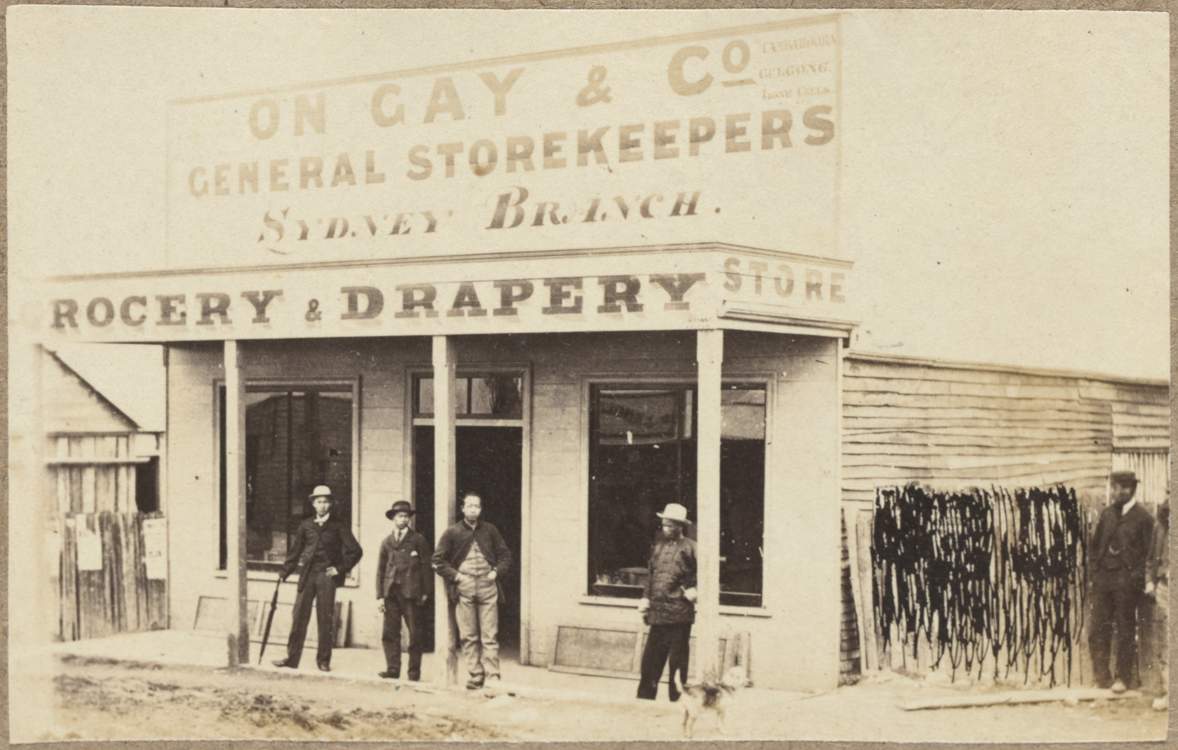 Group of men outside the weatherboard and slab Chinese store of On Gay & Co. general storekeepers
