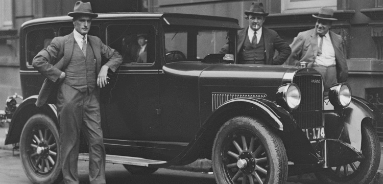 Australian Labor Party member standing beside a car, New South Wales,1930