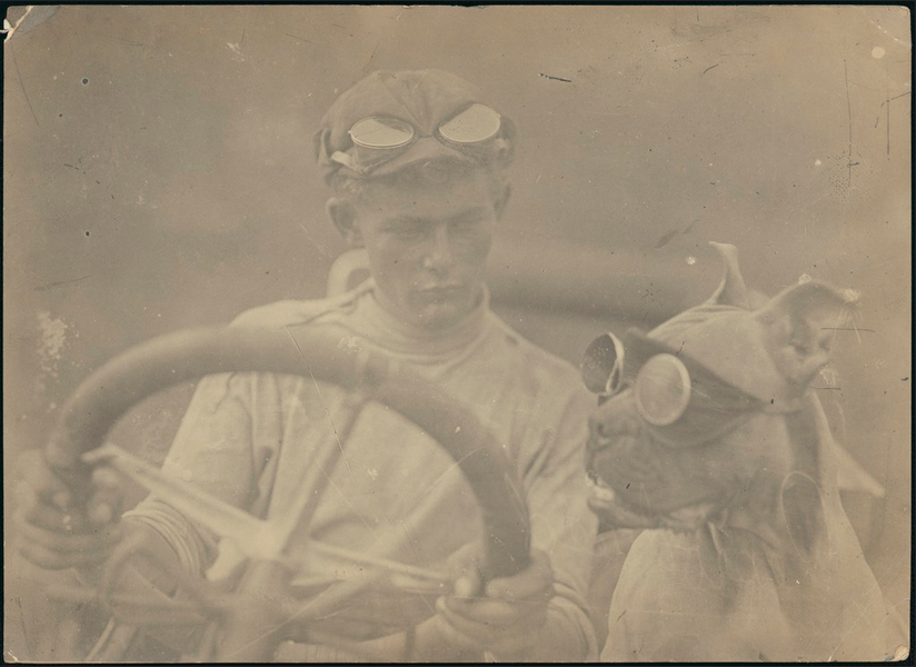 [Clive Birtles at the wheel of the car with the dog, Wowser] in the Fashionable Eyewear album of the National Library of Australia's Flickr Commons