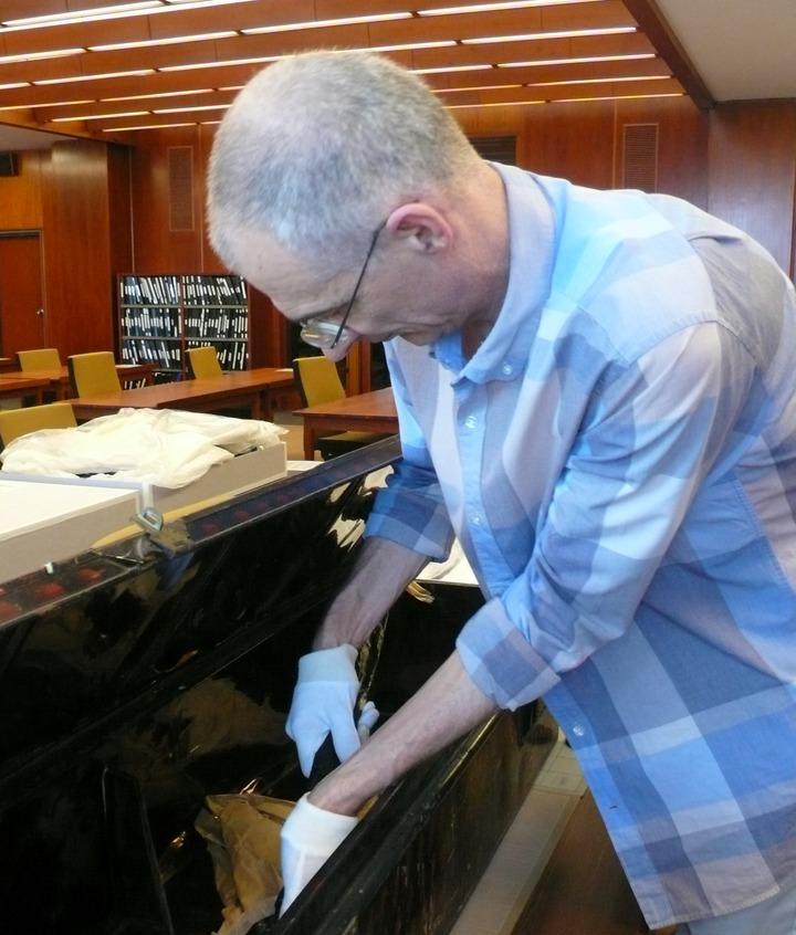 Craig Wilcox unpacking Shaw's trunk