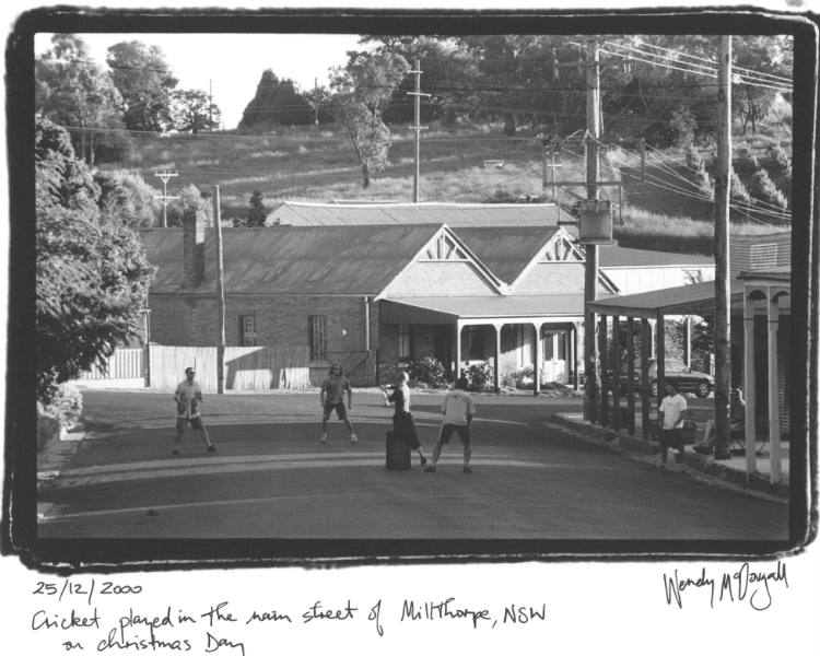 Cricket played in the main street of Millthorpe, NSW on Christmas day