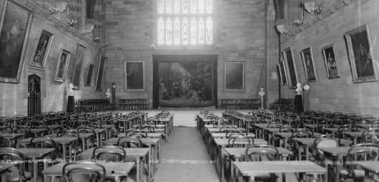 Rows of desks and tables set up for exam in the Sydney University Great Hall