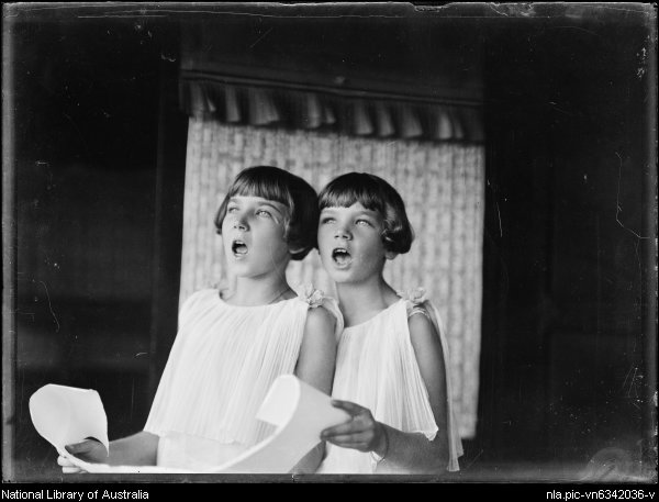 Picture of two girls singing carols