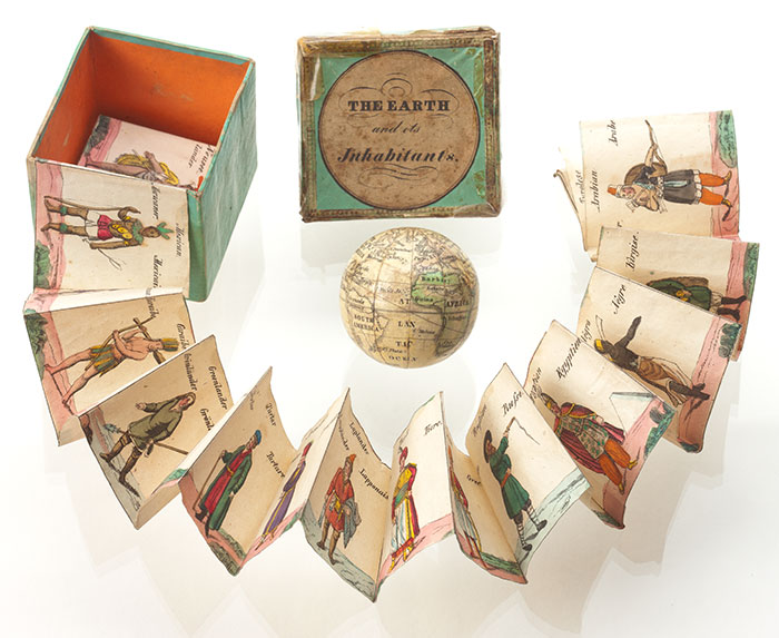 A pocket-sized globe with it's box and a fold-out leaflet