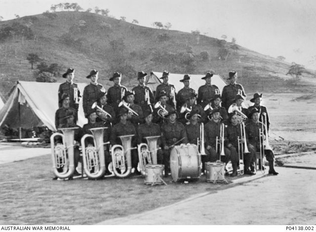 Group portrait of 25 members of 2/22 Battalion Regimental Band, 23 of whom were originally members of Salvation Army bands who had enlisted in 1940