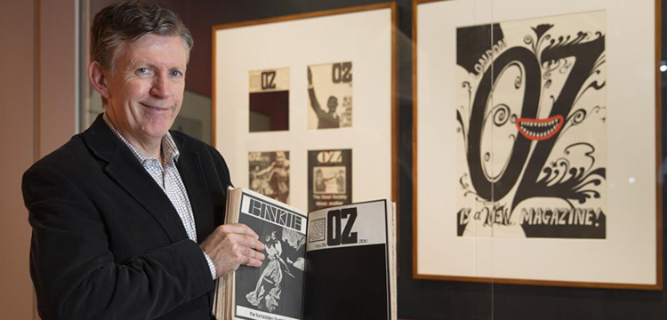 1968 Exhibition Curator Guy Hansen with Oz magazine display