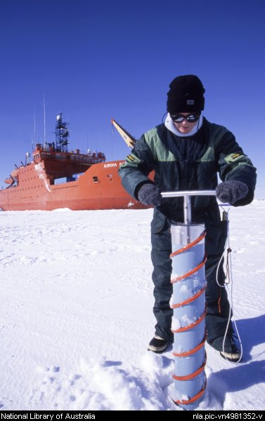Picture of Research assistant Naomi Petrie drilling an ice core sample