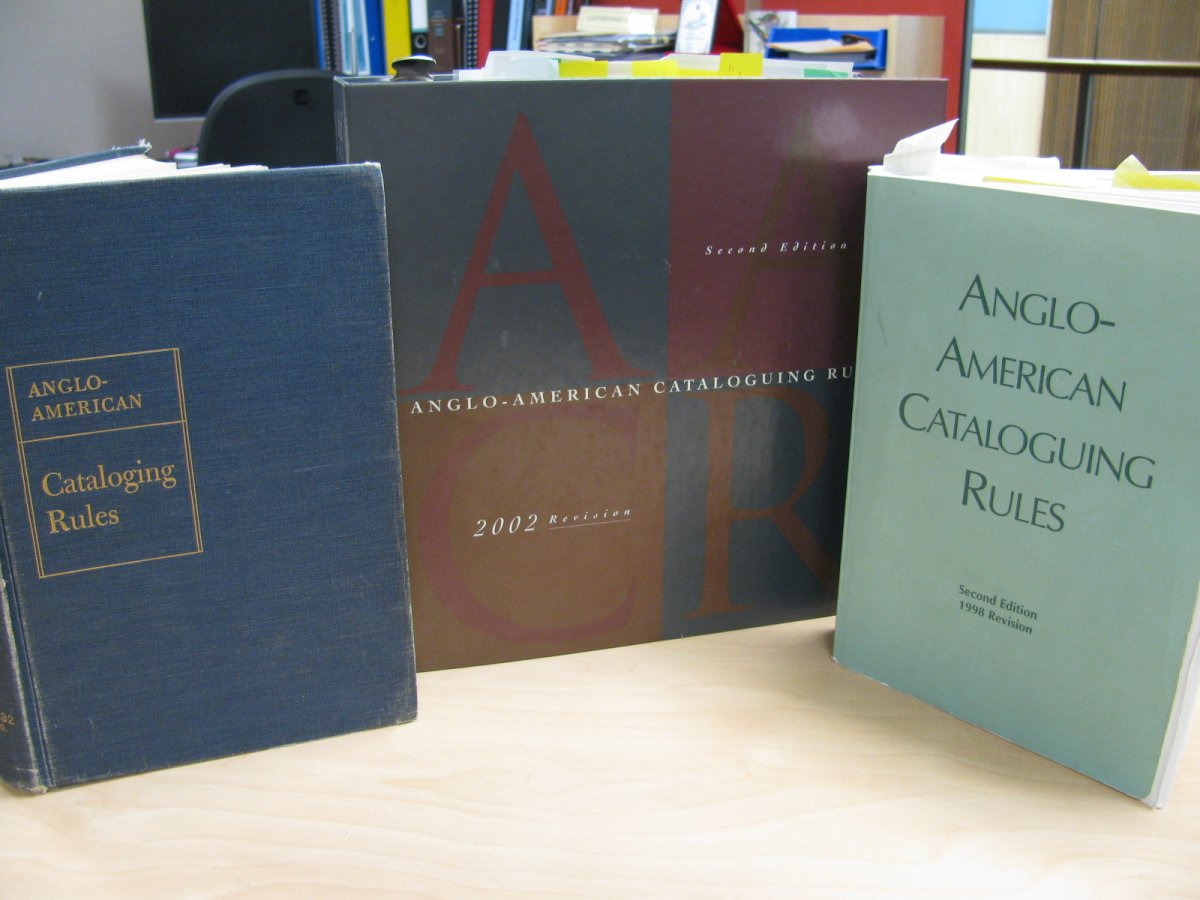 Three copies of different editions of AACR.