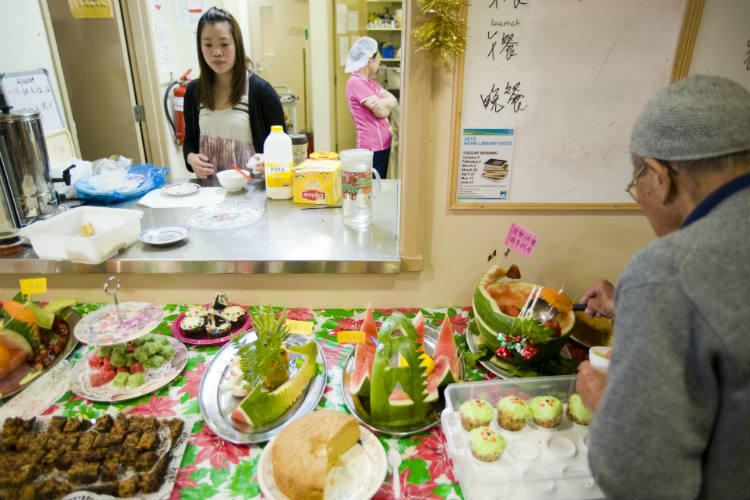 Display of lunch buffet, including watermelon, sponge cake and cupcakes, during Christmas celebrations at Elderly Chinese Home, Parkville, Victoria, 13 December, 2009