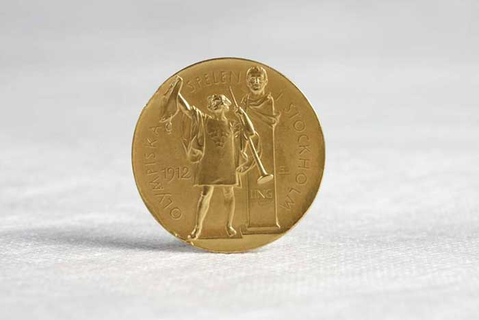 A gold medal from the 1912 olympics