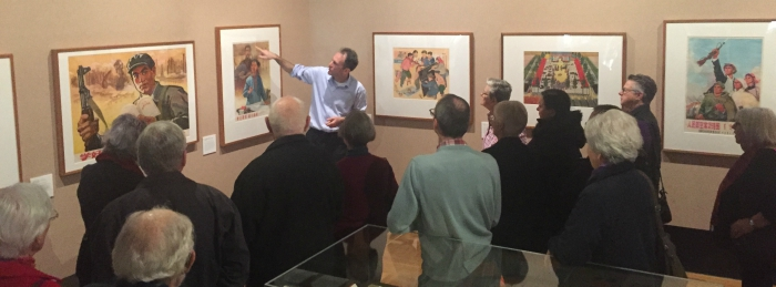 Curator Nathan Woolley conducts a tour of the 'Waving the Red Flag' exhibition