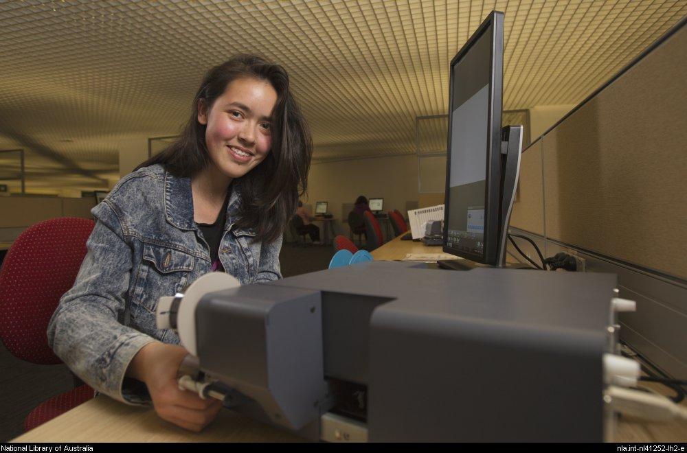 Sydney using the microfilm reader