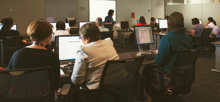 Photograph taken at digital skills training at the National Library of Australia. Trainees are sitting at computer terminals.