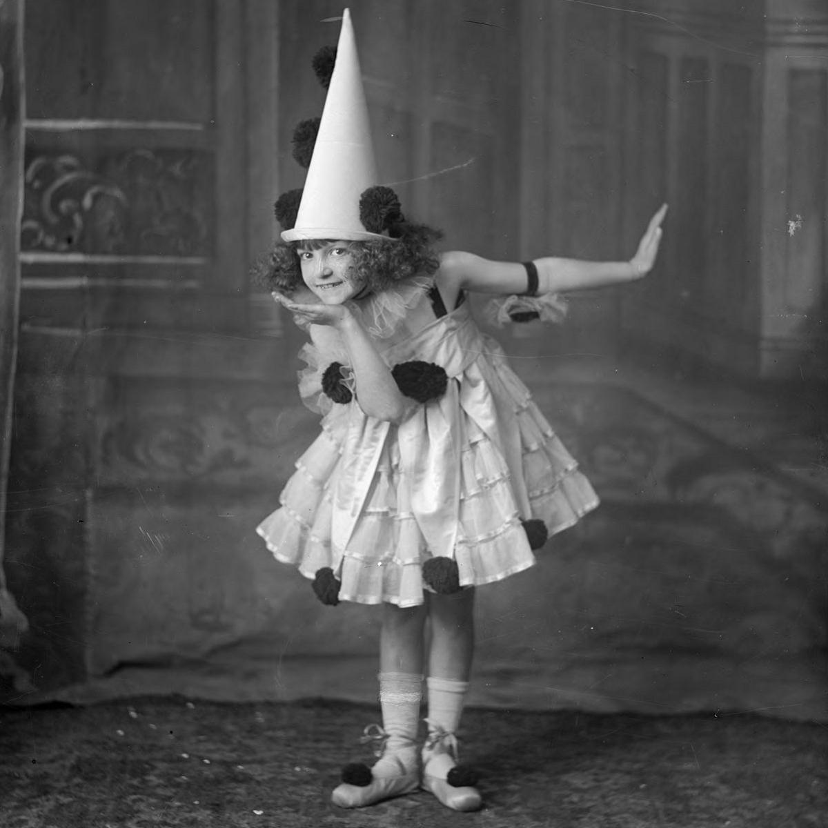 Child posing in Pierrot costume in 1915