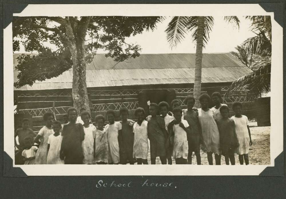 Group of school children stand out the front of the school on Badu Island, Queensland, ca. 1928
