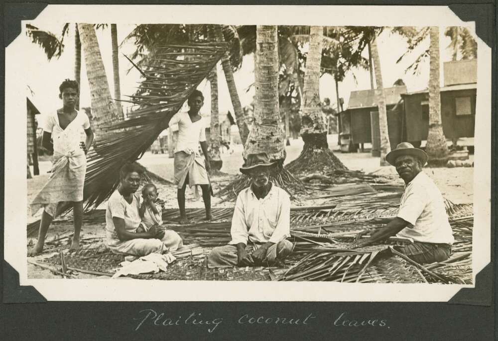 Villagers plaiting the leaves from the coconut palms, Badu Island, Queensland, ca. 1928