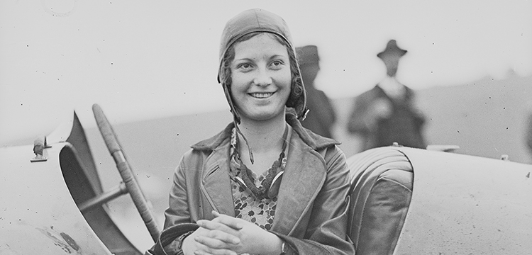 Woman sitting in a race car at the Gerringong Motor Races, New South Wales, 10 May 1930