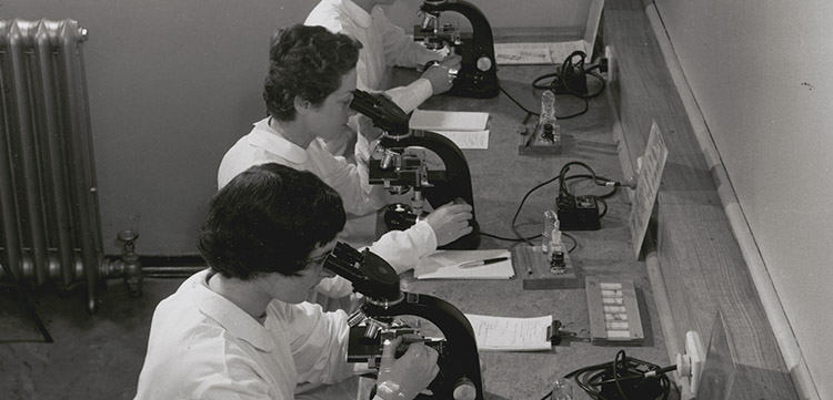 Skilled technicians study slides of cells in body fluids, looking for abnormalities suggestive of cancer at the Royal Womens Hospital, Melbourne