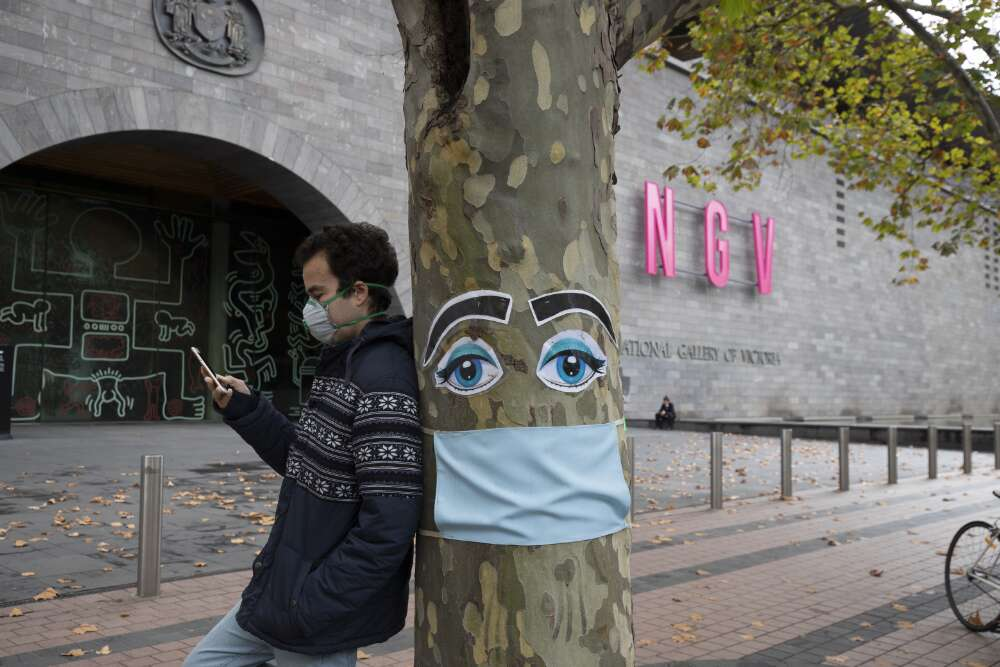 Henningham, Leigh. (). A tree decorated in face mask outside the National Gallery of Victoria, during the COVID-19 pandemic, Melbourne, Victoria, 26 April 2020