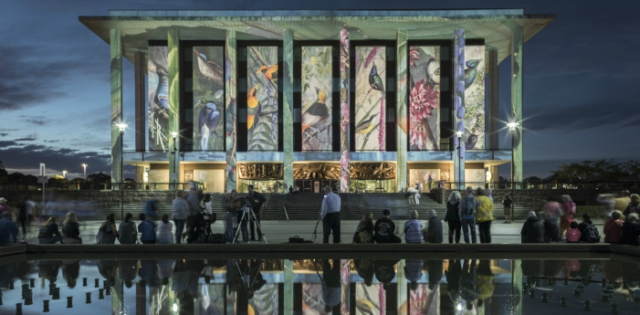 Ellis Rowan illustrations projected on the National Library of Australia building for Enlighten 2017.