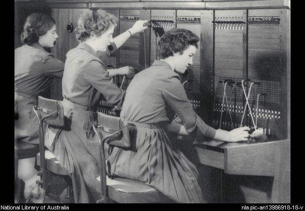 Telephone exchange operators send through calls