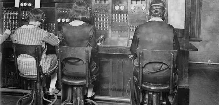 Three female telephone operators at a switchboard