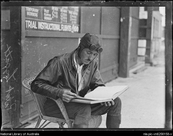 1920s aviator reading a book