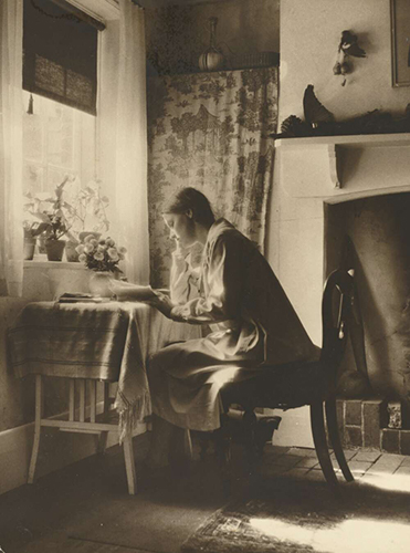 Nora Heysen seated at desk