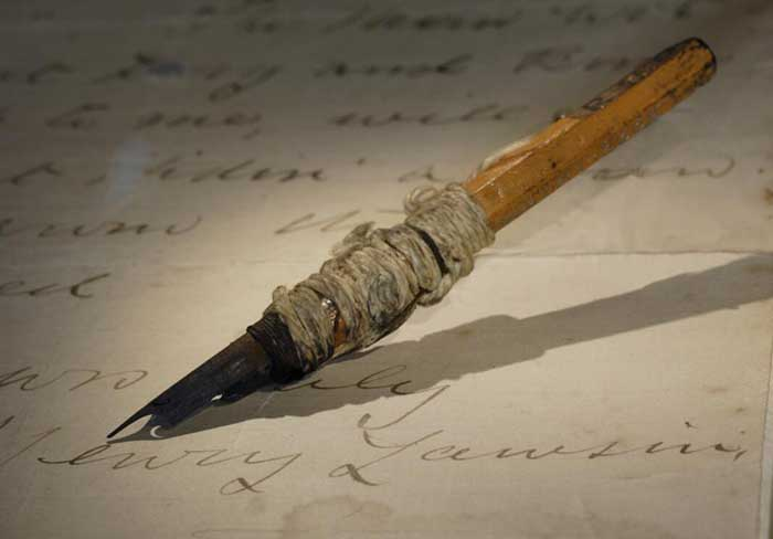 a pen hovering over a page written on by Henry Lawson