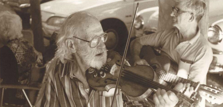 Photograph of Les Dow playing the fiddle