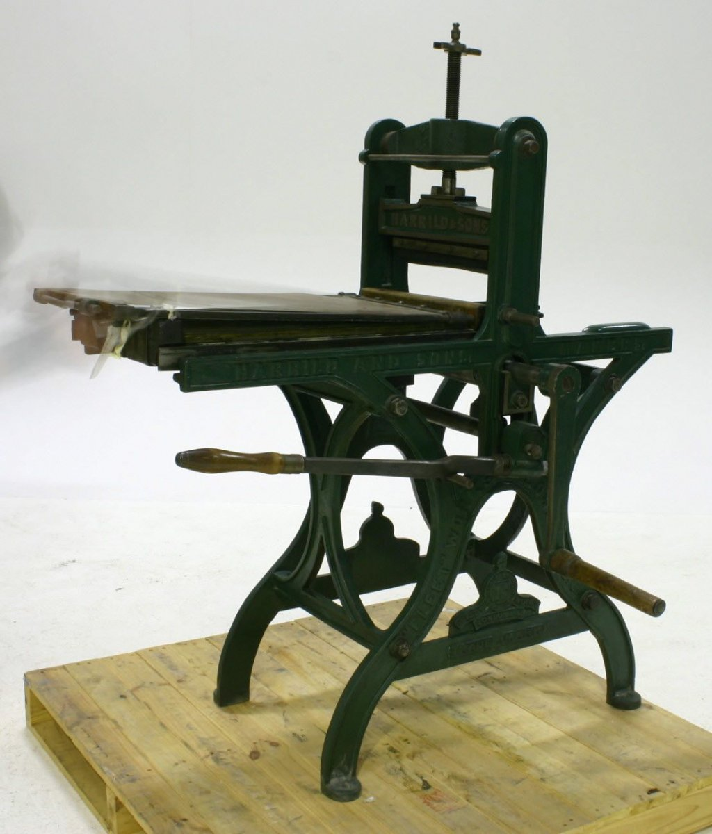 A lithographic printing press with a green frame and flatbed plate, manufactured by Harrild & Sons.