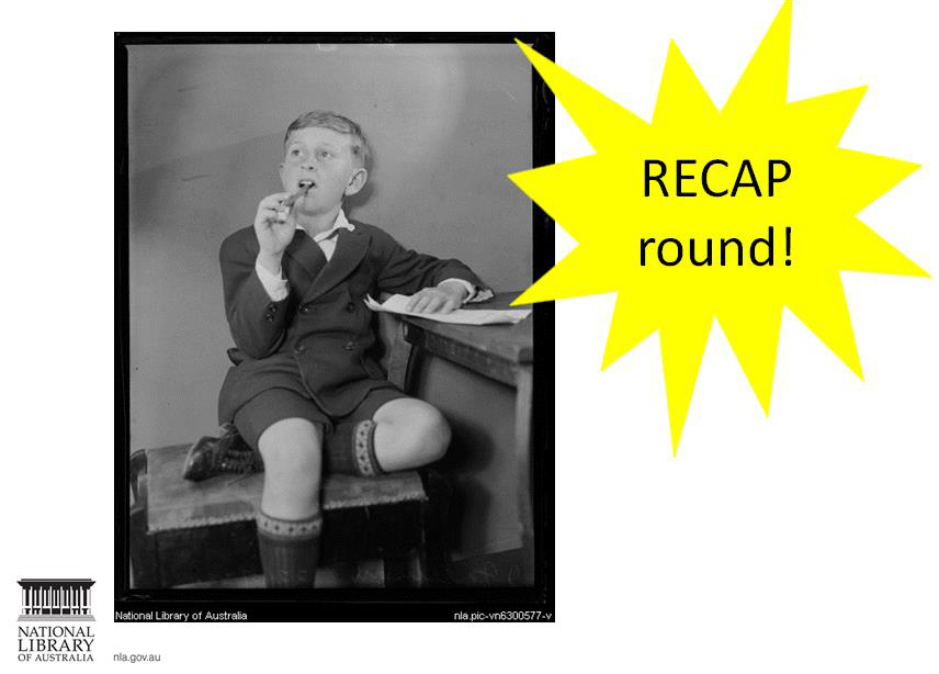 Slide from training titled 'RECAP round!'. Slide shows an old photograph from the National Library's collection of a school child thinking with a pen in his mouth.