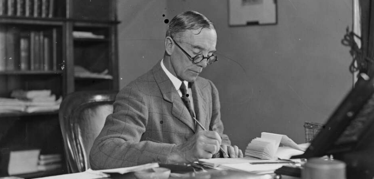 Sir Philip Game writing at his desk
