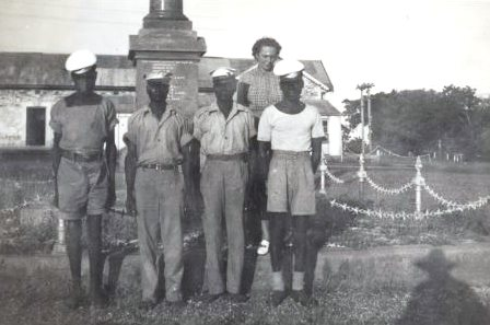 Dorothy Amos with four local men in uniform, Darwin, Northern Territory, January 1947