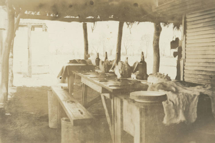 Christmas dinner table in the men's quarters, Davenport Downs Station, south west Queensland, ca. 1925