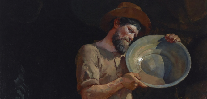 A prospector holding a pan.