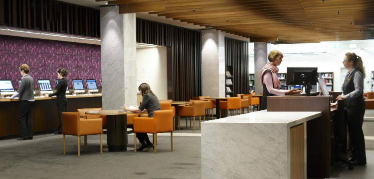 People using the main reading room at the Library