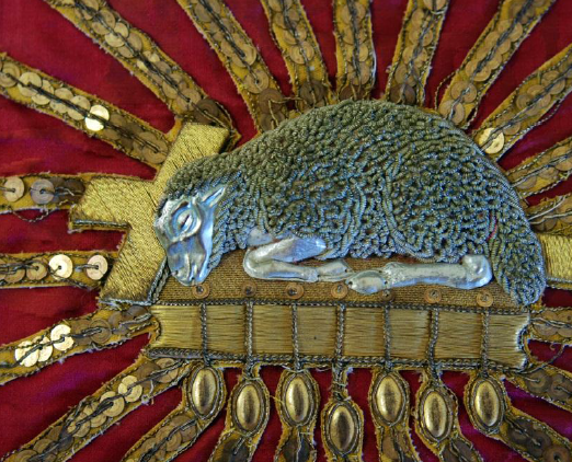 closeup image of sheep embroidery on veil