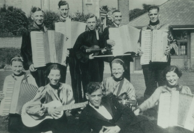 Picture of 'Billy Burton's' accordion band. Billy Burton is front and centre.