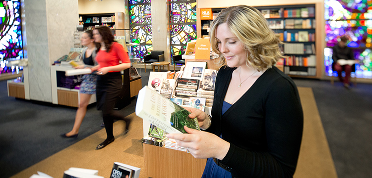 Woman browsing the National Library Bookshop
