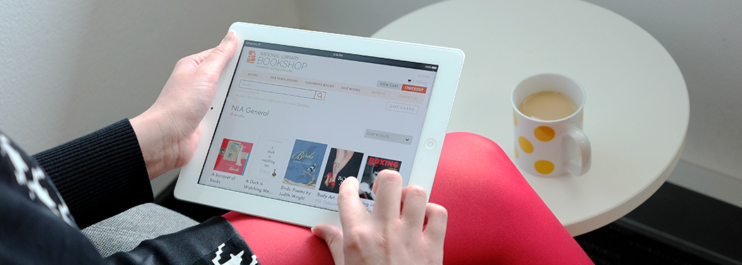 A person looking at the online bookshop on a tablet