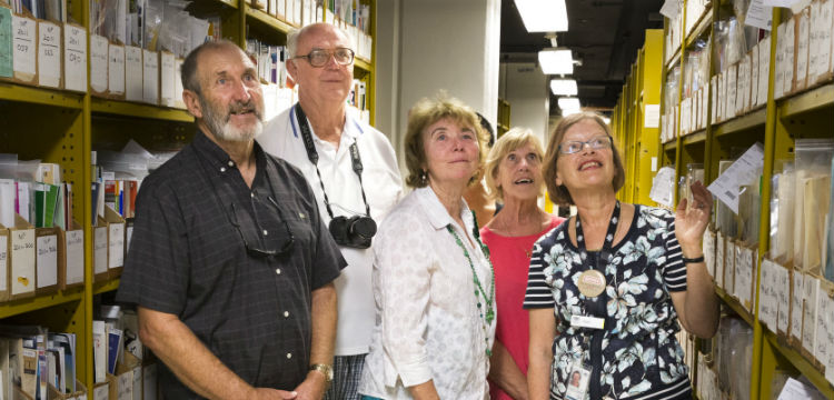 A tour group in the Library stacks